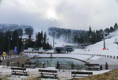 View of the mountains, ski slopes and lake Stock Photos