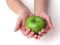 Apple in hand Stock Photos