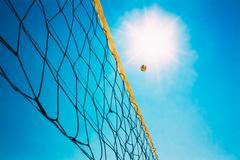 Volleyball Ball Over Net On Background Of Blue Summer Sunny Sky Kuvituskuvat
