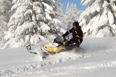 Athlete on a snowmobile Stock Photos