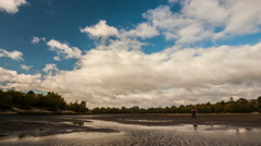 Movement of clouds over the river  Stock Footage