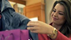Happy woman checking her shopping bag in shopping mall HD Stock Footage