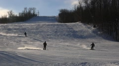 Downhill skiers skiing in ski resort in Ontario Stock Footage