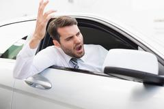 Stock Photo of Businessman experiencing road rage