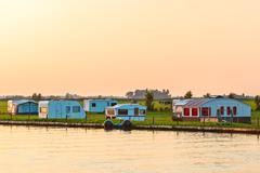 dutch camping site during sundown - stock photo