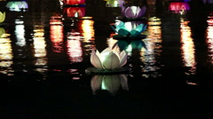 Lotus paper river lantern floating in river at night Stock Footage