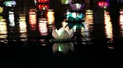 lotus paper river lantern floating in river at night - stock footage