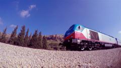 Passenger train passing through_fisheye perspective_2 (4k) Stock Footage