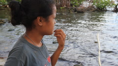 Women Explains Fishing Net Cleaning on the Island of Yap Stock Footage