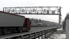 Vehicles passing a control gantry on German highway - stock footage