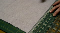 Cutting piece of fabric on cutting mat Stock Footage