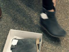 Woman trying shoe in shoe store NTSC - stock footage