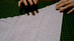 Preparing piece of fabric for sewing Stock Footage