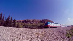 Passenger train passing through_fisheye perspective 1 (4k) Stock Footage