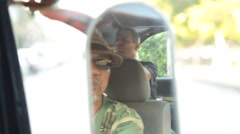 Reflection of a man during the travel in a taxi across the city Stock Footage