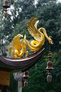 Golden fantasy animal decoration of a chinese style pagoda Stock Photos