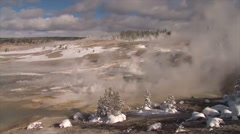 Old Faithful erupts in winter in Yellowstone National park. - stock footage