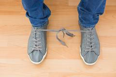 Mans shoes with tangled laces Stock Photos