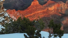 A slow tilt up to the Grand Canyon rim at sunset or sunrise. - stock footage