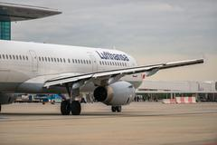Budapest, hungary - march 5 - lufthansa airbus a319 taxiing to the gate after Stock Photos