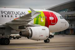 Stock Photo of budapest, hungary - march 5 - tap portugal flight, airbus a320 taxiing to the