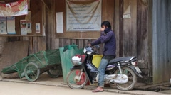 Man standing with the motorcycle waiting for something Stock Footage
