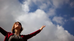 Attractive young woman spreading her arms toward the sky Stock Footage