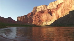Pretty shot of the Grand Canyon at dawn or dusk with river in foreground. - stock footage