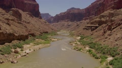 Fast low aerial over the Colorado River in the Grand Canyon. - stock footage