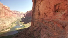 Hikers on a narrow trail along a cliff in the Grand Canyon. Stock Footage