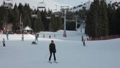 People skiing on slope. Skiers ride on ski lift. Down the slope. Winter. Stock Footage