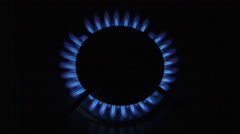 Blue flames of gas burning from a kitchen gas stove Stock Footage