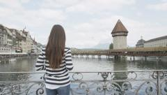 Tourist taking photograph in Lucerne Switzerland ravel tourist with smart phone Stock Footage