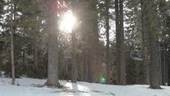 Skiers riding on ski lift, view through the forest trees, people on snow. Stock Footage