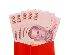 Thai baht banknotes in red packet Stock Photos