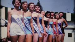 1606 - beauty pageant contestants pose for photos - vintage film home movie Stock Footage