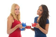 Girlfriends drinking tea Stock Photos