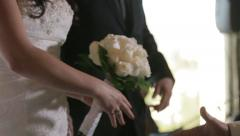 Bride and groom shaking hands with guests Stock Footage