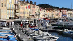 SMALL BOATS MOORED IN ST TROPEZ HARBOUR Stock Footage