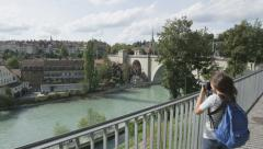 Tourist taking photograph picture in Bern with SLR in Switzerland Stock Footage
