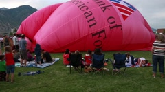 People at a hot air balloon festival Stock Footage