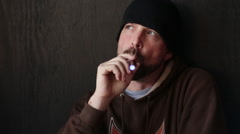 Thoughtful Man  with Beanie Cap and Beard Vapes Smokes an E-Cigarette Stock Footage