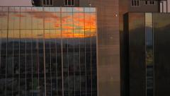AERIAL: Sunrise reflection in big office building Stock Footage