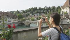Woman taking photograph picture in Bern - STEADICAM SLOW MOTION Stock Footage