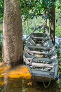 Wooden boat at river shore in Amazon River Stock Photos