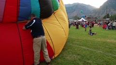 Filling up a hot air balloon at a festival Stock Footage