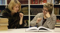 Two women at a library Stock Footage