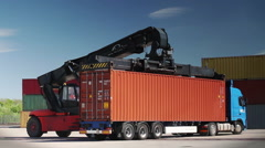 Container Handler loading a Truck in Port Terminal. No Logos. Stock Footage