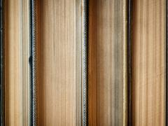 Background made of old books arranged in stacks Stock Photos