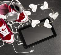 love for music concept.red sneakers, headphones, tablet,hearts. - stock photo
